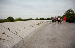 Arlington national cemetery. WASHINGTON D.C., MAY 26, 2014: Tourists leave flowers for fallen soldiers at Arlington National Cemetery during Memorial Day weekend Royalty Free Stock Images