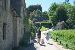 Arlington Row in Bibury. Cotswold, United Kingdom-May 26, 2017:Bibury is a village in Gloucestershire, England. The village is known for its honey-coloured Stock Photography