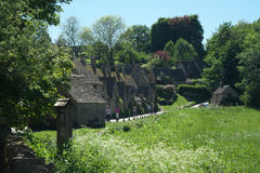 Arlington Row in Bibury. Cotswold, United Kingdom-May 26, 2017:Bibury is a village in Gloucestershire, England. The village is known for its honey-coloured Royalty Free Stock Photos