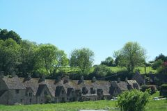 Arlington Row in Bibury. Cotswold, United Kingdom-May 26, 2017:Bibury is a village in Gloucestershire, England. The village is known for its honey-coloured Stock Images