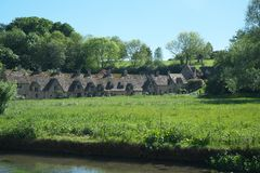 Arlington Row in Bibury. Cotswold, United Kingdom-May 26, 2017:Bibury is a village in Gloucestershire, England. The village is known for its honey-coloured Stock Photos