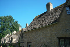 Arlington Row in Bibury. Cotswold, United Kingdom-May 26, 2017:Bibury is a village in Gloucestershire, England. The village is known for its honey-coloured Stock Photo