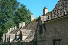Arlington Row in Bibury. Cotswold, United Kingdom-May 26, 2017:Bibury is a village in Gloucestershire, England. The village is known for its honey-coloured Royalty Free Stock Photo