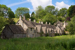 Arlington Row in Bibury, Cotswolds, UK. Arlington Row in Bibury with River Coln, Cotswolds, Gloucestershire, UK Stock Images