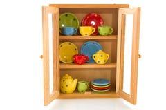 Armário com louça alegre Imagem de Stock
