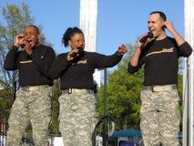 armébandtrio oss Fotografering för Bildbyråer