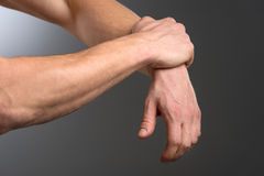 Arm Ache. Man holding painful hand Royalty Free Stock Images