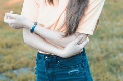 Arm ache outdoors, injured arm royalty free stock image