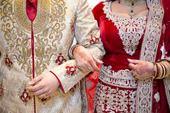 Arm in arm. Asian bride and groom arm in arm Royalty Free Stock Photography