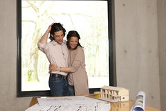 Arm in arm with the house model Royalty Free Stock Photo