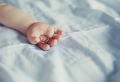 Arm of a baby Stock Photos