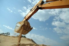 Arm of backhoe. And bucket full of sand Royalty Free Stock Image