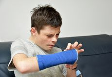 Teenage boy with right arm in plaster royalty free stock photography