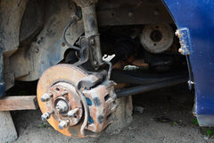 Arm and break disc of a car. Arm and break disc of a blue car under repair suspended for easy access to under parts. tire not visibly available Stock Images