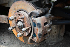 Arm and break disc of a car. Under repair suspended for easy access to under parts. tire not visibly available Stock Photos