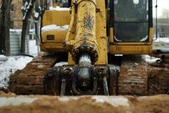 Bucket cylinder of old excavator in winter outdoor, close-up. Arm and bucket cylinder of old excavator in winter outdoor, close-up stock image