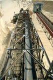 Arm of bucket wheel. Sand mining Stock Photos