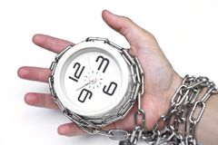 Arm chained with a clock. / time management royalty free stock photo