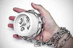 Arm chained with a clock. / time management stock photography