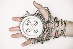 Arm chained with a clock. / time management royalty free stock photos