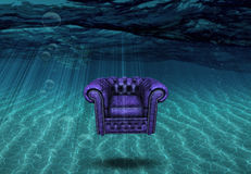 Arm chair floats above bottom of sea. Arm chair floats above sea bottom Royalty Free Stock Images