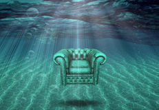 Arm chair floats in sea bottom. Arm chair floats above sea bottom Royalty Free Stock Images