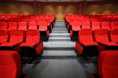 Arm-chairs and gangway are in empty hall Royalty Free Stock Photo