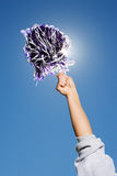 Arm of a cheerleader holding pom-pom Royalty Free Stock Photo