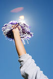 Arm of a cheerleader holding pom-pom Royalty Free Stock Images