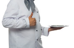 Arm chef holding a tray stock photography
