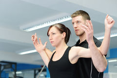 Arm & chest stretching with personal trainer royalty free stock photo