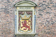 Arm of Coat and Hollandia Bas Relief Royalty Free Stock Photos