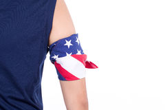 Arm coiled with handkerchief designed like USA flag Royalty Free Stock Image