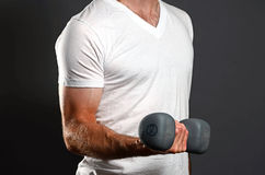 Arm Curl. Image of a man performing a bicep curl Stock Photography