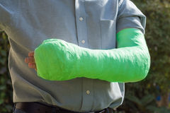 Arm and elbow plaster cast outdoors Stock Photos
