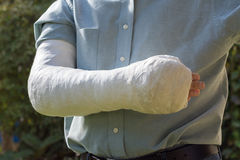 Arm and elbow plaster cast outdoors Stock Photo