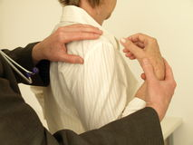 Arm examination - range of movement. Examination of elder woman's arm, closeup stock photos