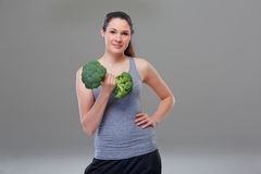 Arm exercise with broccoli looks like a dumbbell Stock Photos
