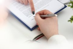 Arm fill and sign important form clipped to pad stock photos