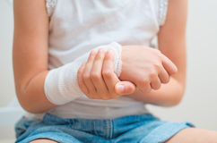 Arm with gauze bandage. Stock Photo