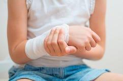 Arm with gauze bandage. Child arm with gauze bandage on it Stock Photo