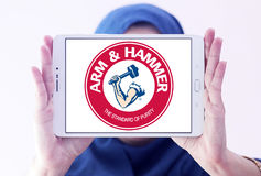 ARM & HAMMER logo. Logo of toothpaste brand ARM & HAMMER on samsung tablet holded by arab muslim woman royalty free stock photo