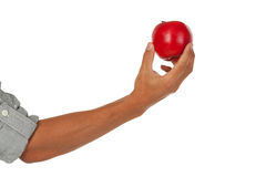Arm with hand holding an apple Royalty Free Stock Photography