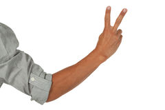 Arm with hand showing the peace sign Royalty Free Stock Photo