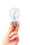 Arm holding light bulb. Isolated on white Stock Photos