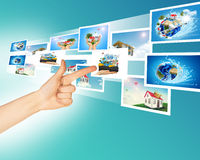 Arm with holographic pictures Royalty Free Stock Images