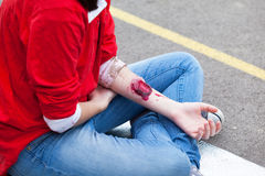 Arm injury. First aid training. Hand injury. Stage makeup Royalty Free Stock Photo