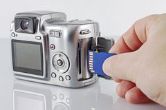 Arm inserts a USB flash drive in the camera royalty free stock photography