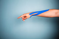 Arm with kinesio tape Royalty Free Stock Image