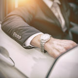 Arm of a man leaning on a car Royalty Free Stock Photo